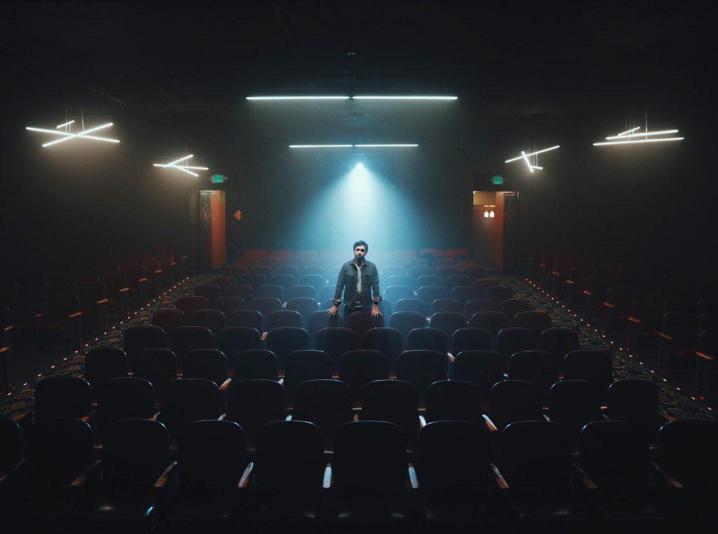 Man in dark theater